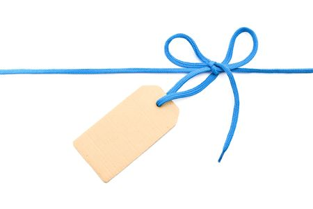 Blue shoelace,bow with cardboard tag photo