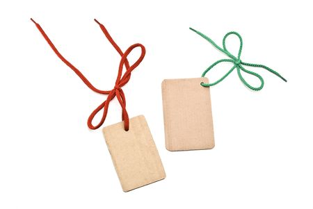 Shoelace with cardboard tags and bow photo