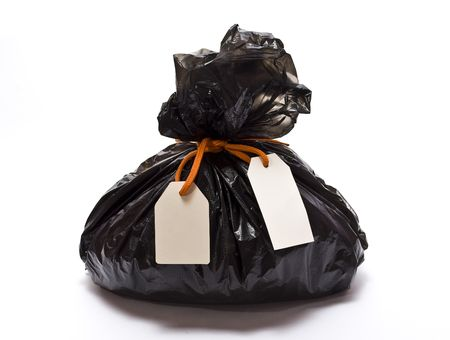 Tied black rubbish bag with lace and tags photo