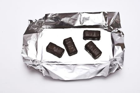 sweetmeats: Chocolate sweetmeats in foil Stock Photo