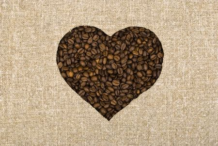 Heart coffee beans and sackcloth background photo