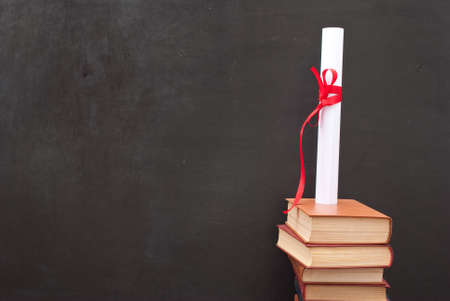 business degree: Chalkboard with a diploma and books Stock Photo