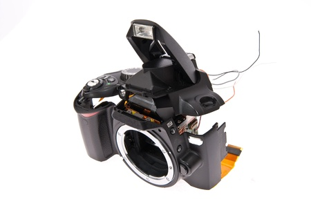 photocamera: Broken and disassembled DSLR photocamera  Stock Photo