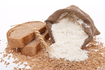 Flour and wheat grain with bread photo