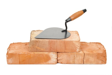 stone work: Trowel on bricks Stock Photo
