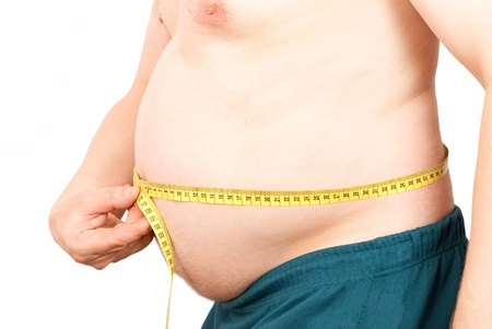 big belly: Fat man holding a measurement Stock Photo