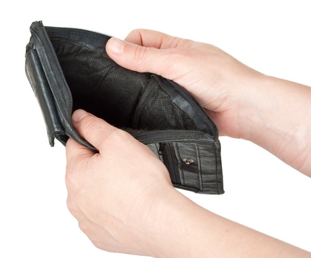 bankrupt: Empty purse in his hands Stock Photo