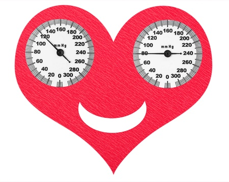 manual test equipment: Happy heart and normal blood pressure on the scales Stock Photo
