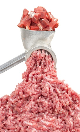 Mincer and a pile of chopped meat photo