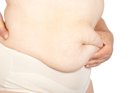 pinching: Fat woman pinching her fat tummy  Stock Photo