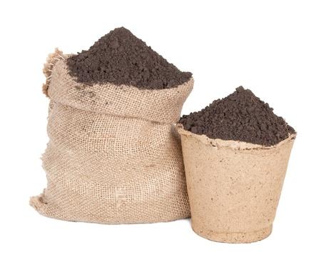 turf: Sack van grond en turf pot Stockfoto