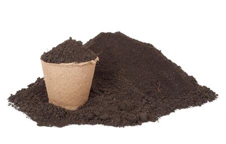 turba: Pila de macetas de suelo y turba