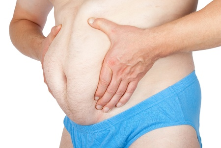 Man grabbing his fat on the stomach  Stock Photo - 16177191