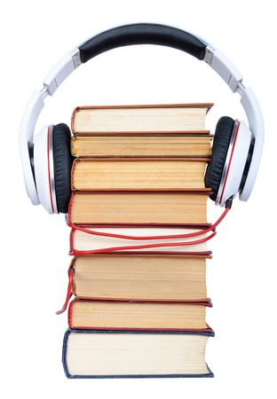 Pile books with headphone