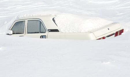 blizzard: Car covered with snow Stock Photo