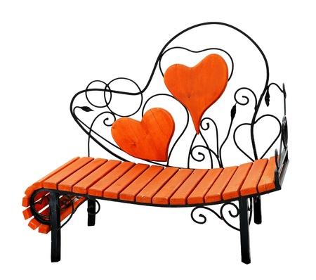 Wooden bench with hearts photo