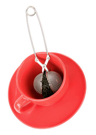 strainer: Tea cup with strainer