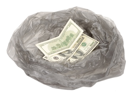 unneeded: Money in a garbage bag