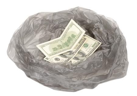 weaken: Money in a garbage bag
