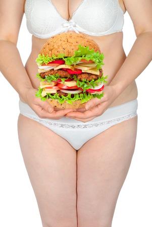 mujeres gordas: Mujer gorda con la hamburguesa