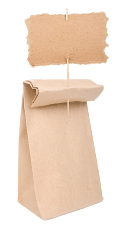 Paper bag with cardboard sign photo