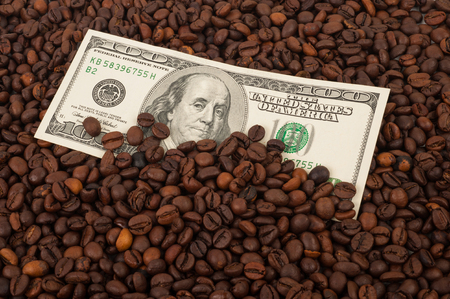 coffee house: Coffee beans with money Stock Photo