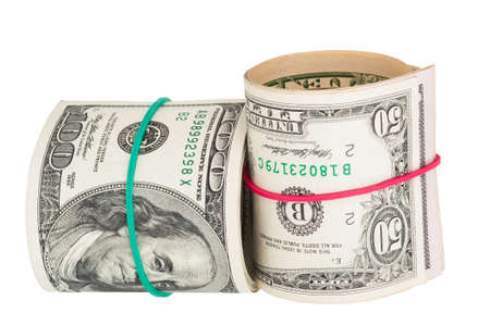 rubberband: Dollar bills rolled up with rubberband Stock Photo
