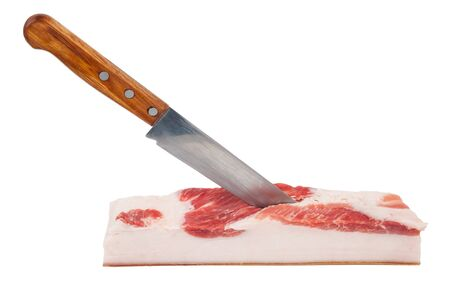 productos naturales: Pedazo de manteca de cerdo con un cuchillo