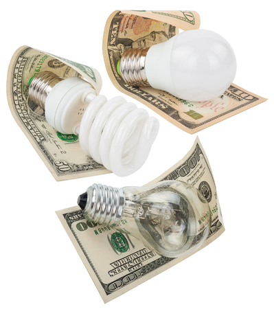 fluorescent lamp: Money saved in different kinds of light bulbs Stock Photo