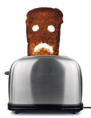 burnt toast: Burnt toast bread  in a toaster