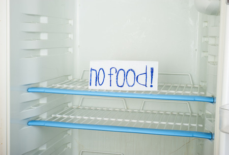money matters: Label  no food  in an empty refrigerator Stock Photo