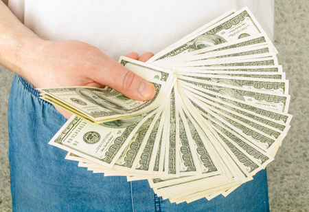 commercial activity: Hand with money