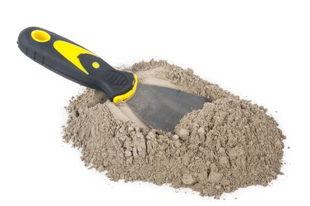 Gray cement powder with trowel