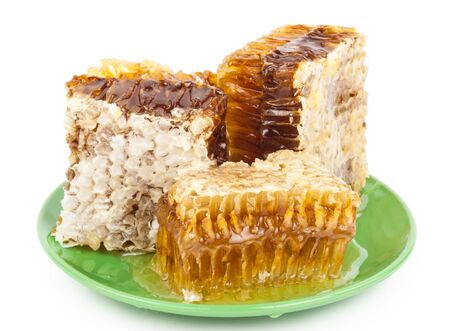 isolated on yellow: Honey comb on a plate Stock Photo