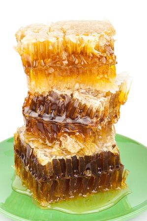honey comb: Honey comb on a plate Stock Photo