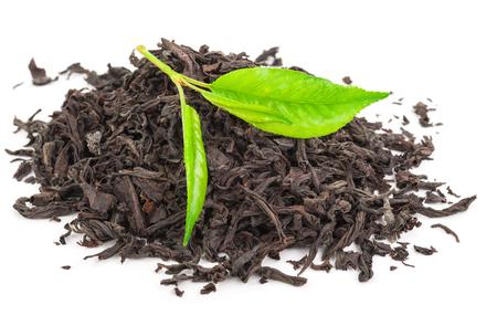 tannin: Heap of dry black tea with green tea leaves