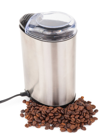 Electric coffee-mill machine with roasted coffee beans Фото со стока