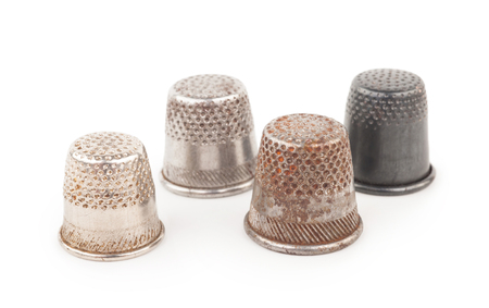 old items: Thimbles on a white background