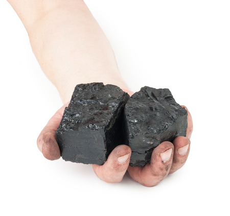 combustible: Pieces of coal in hands