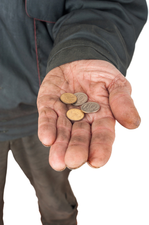 Hand of a beggar with coins Stock Photo