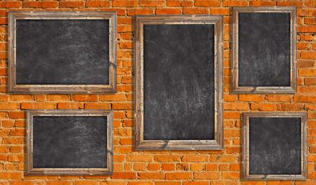 Chalkboards on brick wall