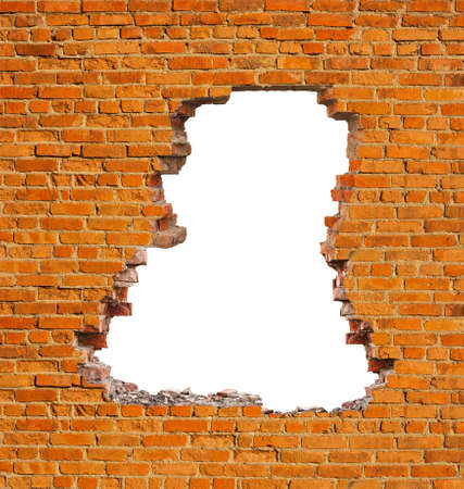Broken hole in an old brick wall