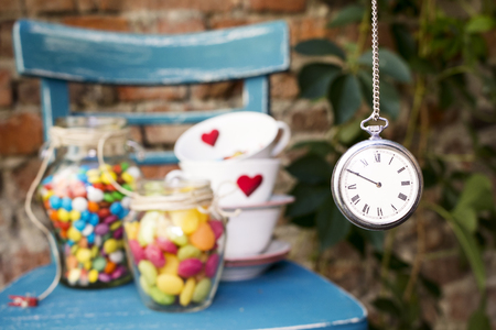 Tea party At The Garden With Watch Hanging
