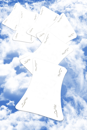 Joker Playing Cards Scatered Over The Blue Cloudy Sky