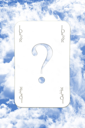 Joker Playing Card Over The Blue Cloudy Sky