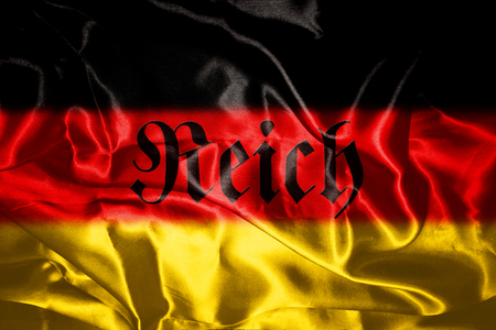 German flag blowing in the wind With Reich Written On It Which Means Realm