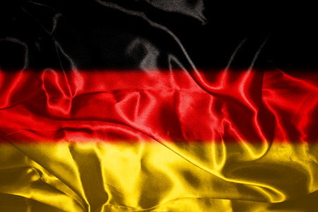 German flag blowing in the wind Stock Photo