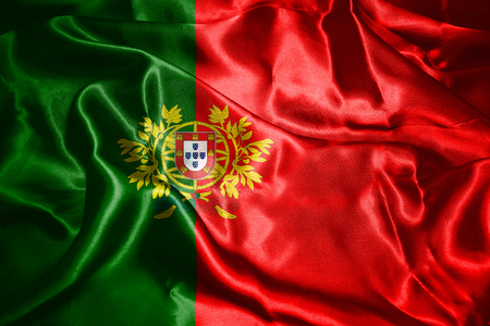 bandera de portugal: Portugal National Flag With Coat Of Arms Waving In The Wind 3D illustration