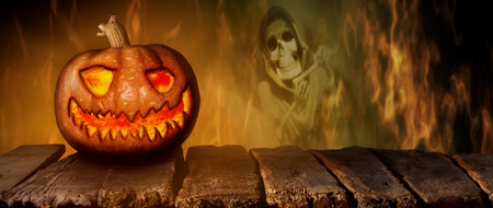 Spooky Halloween Pumpkin On a Wooden Table at Night .With Mistery Horror Background With Cemetery, Death Reaper, Smoke and Fire 3D Illustration Stock Photo