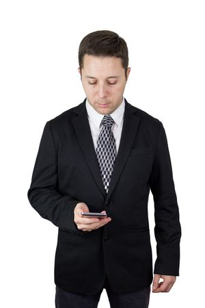 Businessman in Black Suit Holding Smartphone in Hand And Typing Message Against White Background Stock fotó